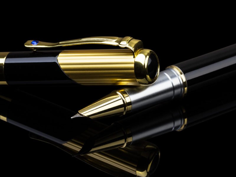 Fountain pen with hooded fine nip